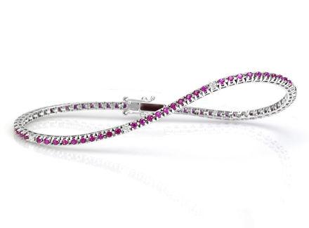 Crieri Icon racciale tennis in oro bianco, rubini e diamanti.