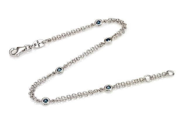 Crieri zefiro bracciale in oro bianco e diamanti blu taglio brillante.